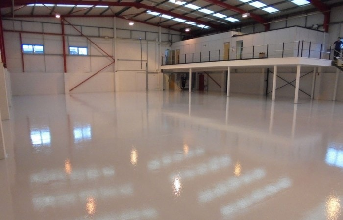 Epoxy resin floor in empty warehouse